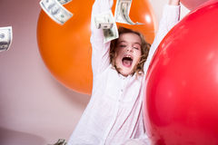 Happy Teenage Girl With An Open Mouth And Falling On Top Of Doll Royalty Free Stock Images