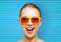 Happy teenage girl or woman face in shades Stock Photography
