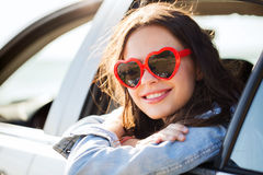 Happy teenage girl or young woman in car Stock Photography