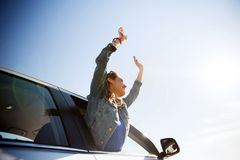 Happy teenage girl or young woman in car Royalty Free Stock Photography