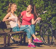 Happy teenage girls with bicycles Stock Photos