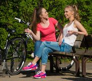 Happy teenage girls with bicycles Royalty Free Stock Image