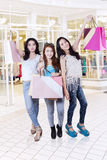 Happy teenage girls carrying shopping bags Stock Images