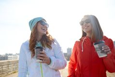 Happy teenage girls with coffee cups on street Royalty Free Stock Images