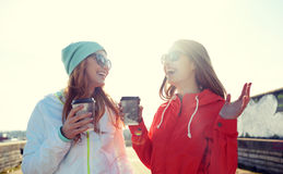 Happy teenage girls with coffee cups on street Royalty Free Stock Image