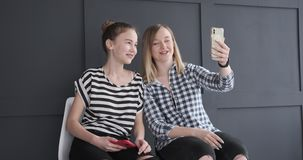 Teenage girls using mobile phone for video chat stock video