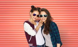 Happy teenage girls or friends in sunglasses stock images