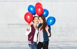 Happy teenage girls with helium balloons Stock Image