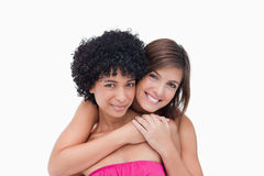 Happy teenage girls hugging each other Royalty Free Stock Images