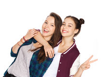 Happy teenage girls hugging and showing peace sign Royalty Free Stock Photos