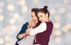 Happy teenage girls hugging and showing peace sign Stock Photos