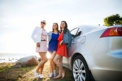 Happy Teenage Girls Or Women Near Car At Seaside Stock Photography
