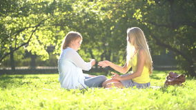 Happy Teenage girls reading a book outdoors. stock footage