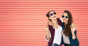 Happy teenage girls in sunglasses showing peace royalty free stock photography