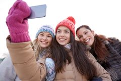 Happy teenage girls taking selfie with smartphone Stock Photo