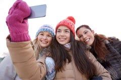 Happy teenage girls taking selfie with smartphone Stock Photo
