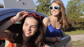 Happy teenage girls or women in car at seaside 25 stock video footage