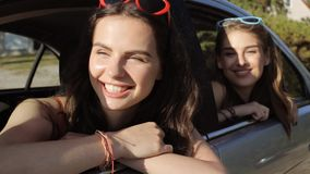 Happy teenage girls or women in car at seaside 24 stock video footage