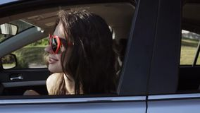 Happy teenage girls or women in car at seaside 26 stock footage