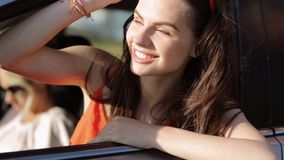 Happy teenage girls or women in car at seaside 64. Summer vacation, holidays, travel, road trip and people concept - happy teenage girls or young women in car at stock footage