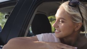Happy teenage girls or women in car at seaside 58. Summer vacation, holidays, travel, road trip and people concept - happy teenage girls or young women in car at stock video footage