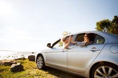 Happy teenage girls or women in car at seaside Royalty Free Stock Photo