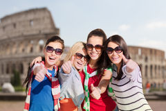 Happy teenage girls or women showing thumbs up Royalty Free Stock Photography