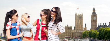 Happy teenage girls or young women in london city Royalty Free Stock Images