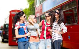 Happy teenage girls or young women in london city Royalty Free Stock Photography