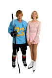 Happy Teenage Hockey and Figure Skater. A teenage winter ice sport couple, hockey player and figure skater Royalty Free Stock Photos