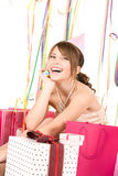 Happy teenage party girl with gifts Royalty Free Stock Images