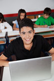 Happy Teenage Schoolboy Sitting With Laptop In Royalty Free Stock Photo