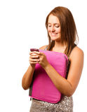 Happy teenage schoolgirl smiling and texting Royalty Free Stock Photos