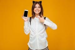Happy teenage schoolgirl in uniform with backpack Stock Photo