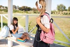 Happy teenage schoolgirls Stock Photos