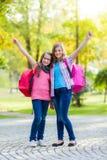 Happy teenage schoolgirls with schoolbag Stock Images
