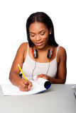 Happy teenage student doing homework Royalty Free Stock Images