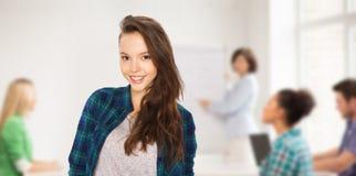 Happy teenage student girl at school stock photos