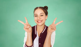 Happy teenage student girl showing peace sign Royalty Free Stock Photo