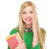 Happy teenage student girl telling good news. Isolated on white stock photography