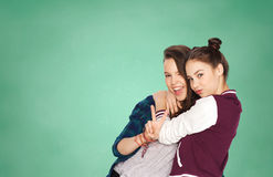 Happy teenage student girls showing peace sign Stock Photos