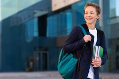 Happy teenage student outdoor looking at copy space stock photography
