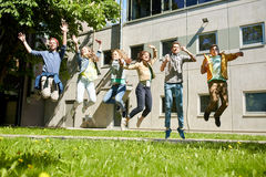 Happy teenage students or friends jumping outdoors Royalty Free Stock Photography