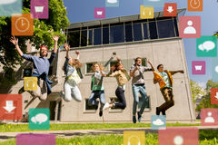 Happy teenage students or friends jumping outdoors Stock Photo