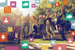 Happy teenage students or friends jumping outdoors Royalty Free Stock Photos