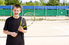 Happy teenage tennis player Royalty Free Stock Photo