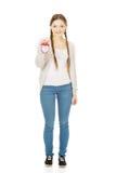 Happy teenage woman with alarmclock. Stock Photo