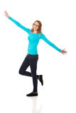 Happy teenage woman with arms wide open Stock Images