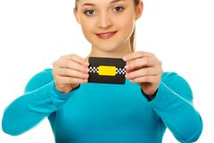 Young woman holding paper card. stock photo