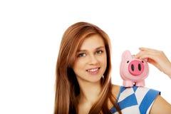 Happy teenage woman holding piggybank Royalty Free Stock Photo